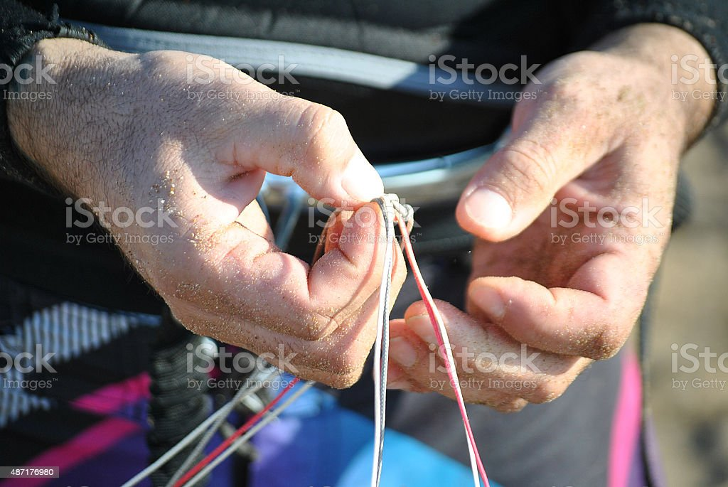 Tying a Square Knot stock photo
