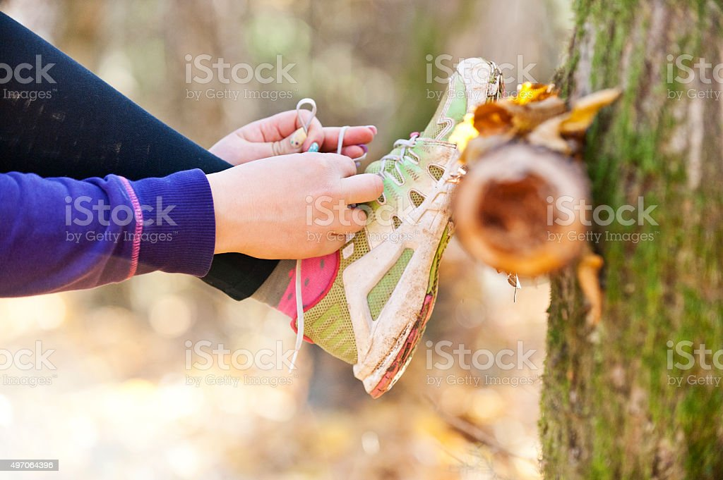 Tying boot laces stock photo