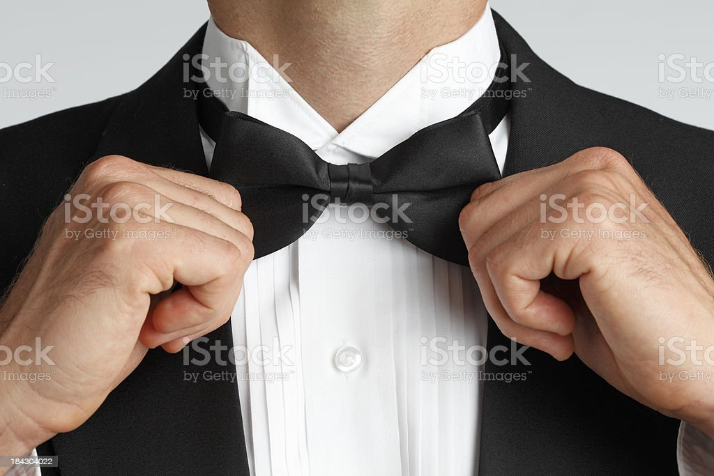Tying Bow Tie stock photo