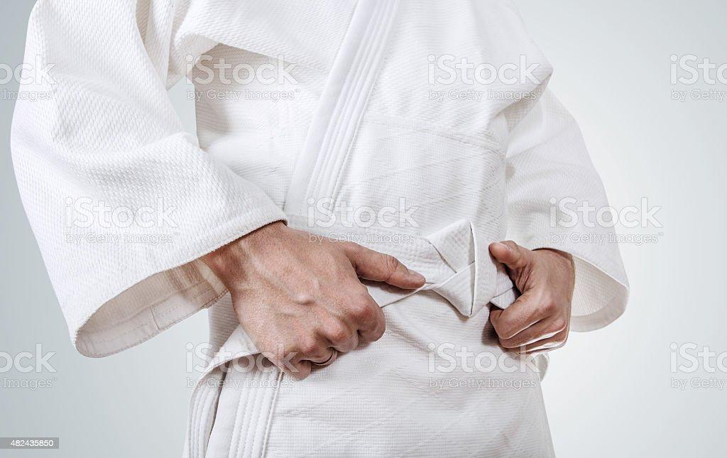 Tying kimono belt close up image stock photo