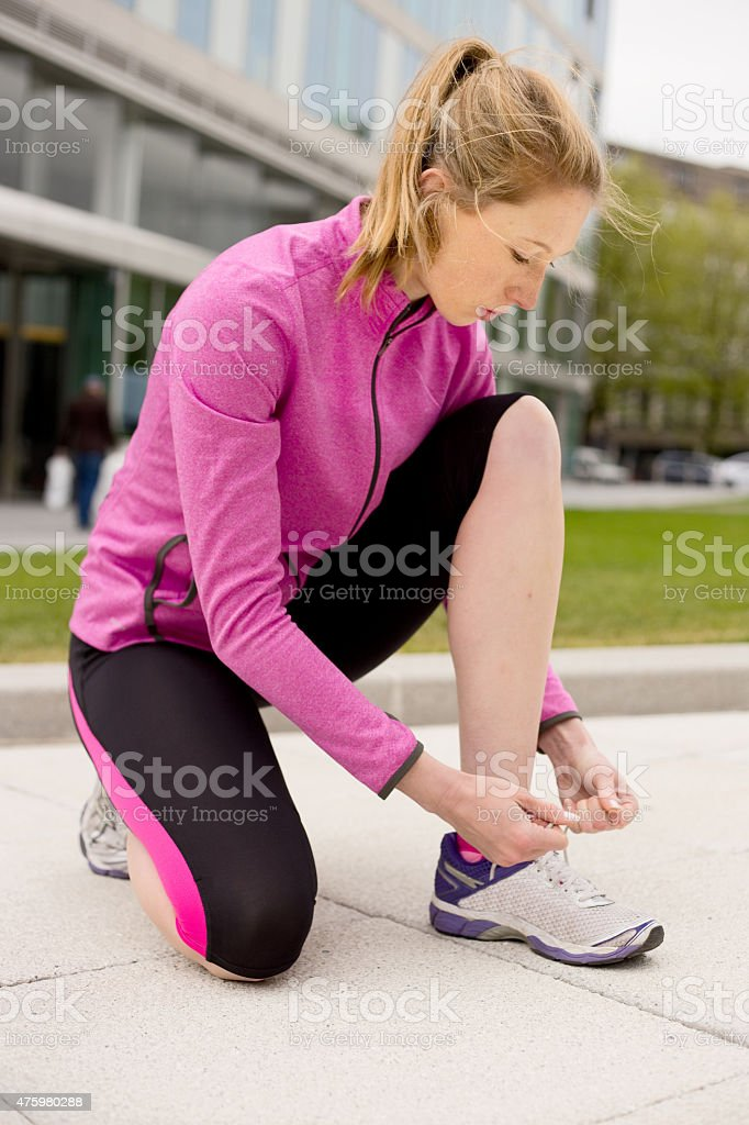 tying laces royalty-free stock photo