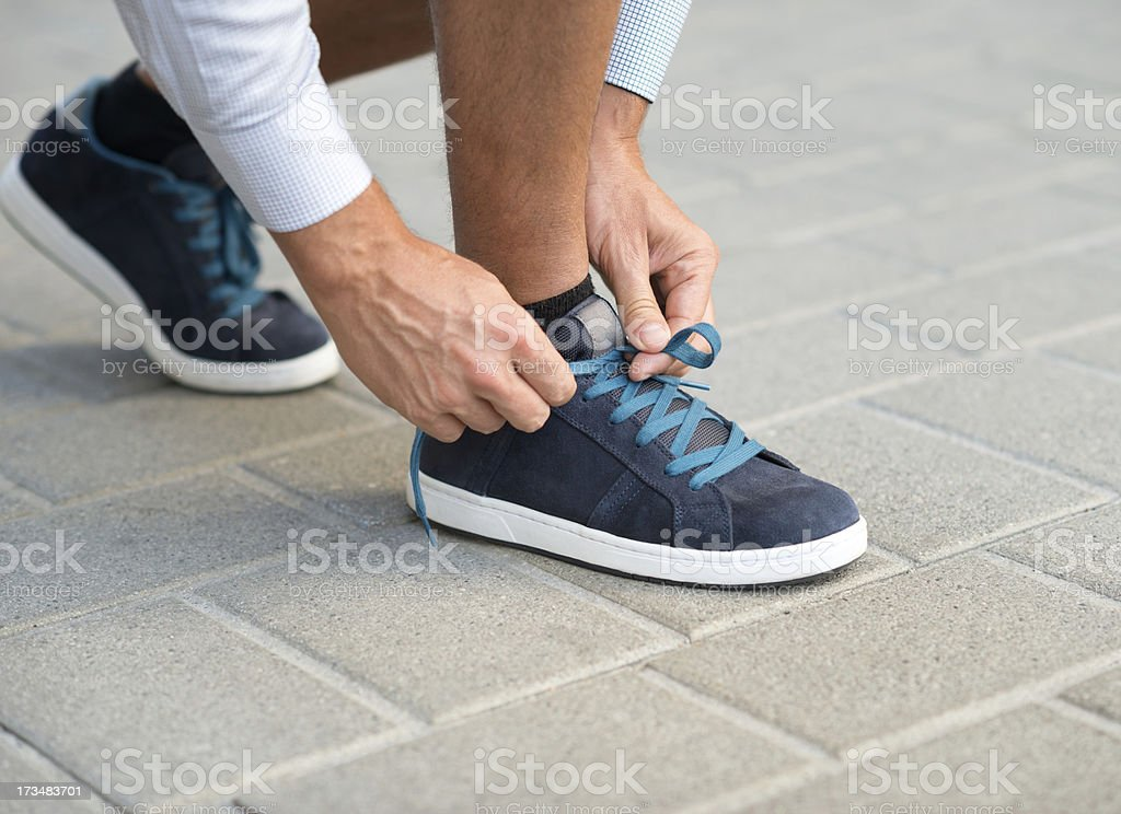 Tying Shoe Laces royalty-free stock photo