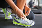 Tying sports shoe at the gym