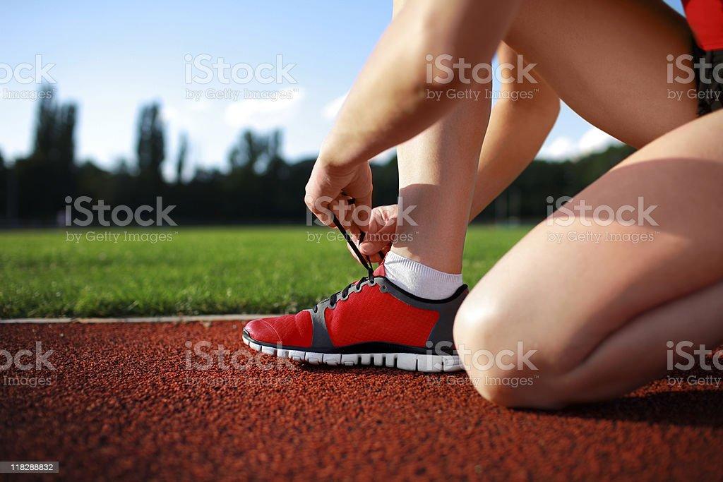 tying sports shoe stock photo