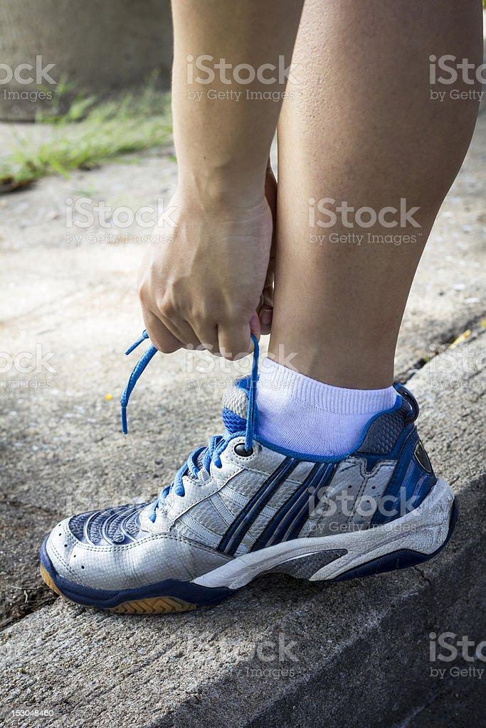 Tying sports shoe royalty-free stock photo