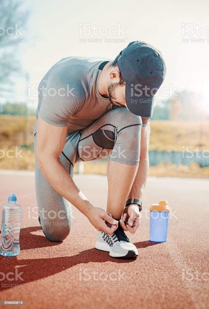 Tying sports shoes. Fitness training outdoors. Sport and exercis stock photo