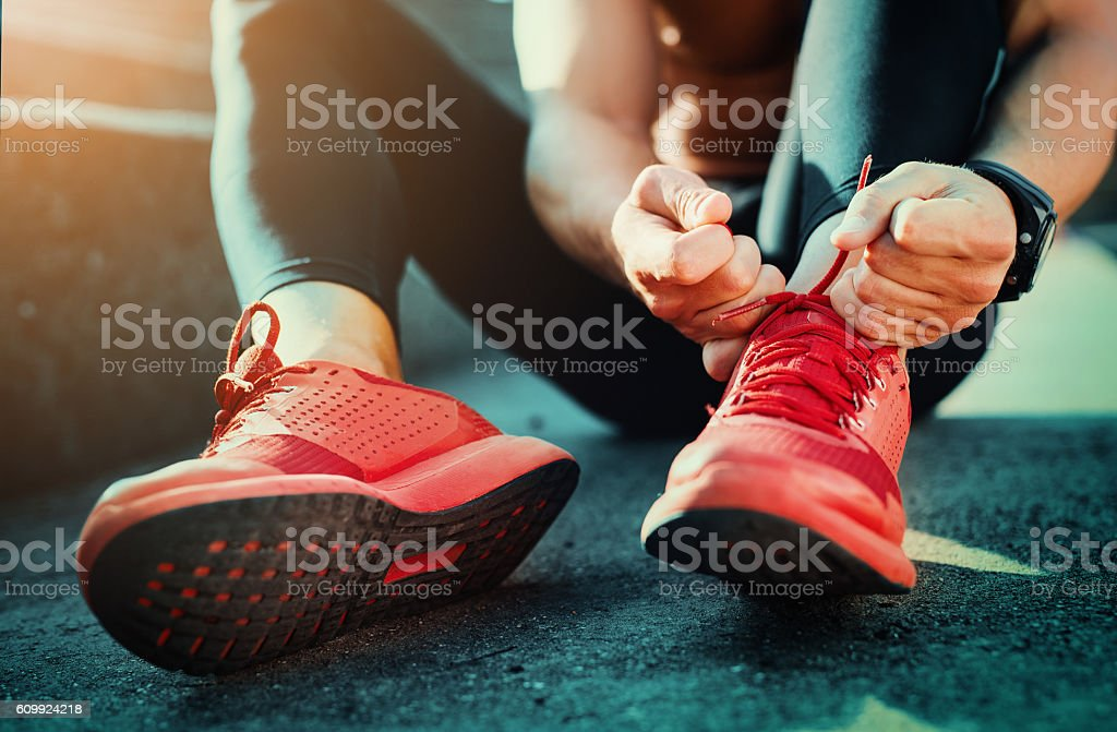 Tying sports shoes royalty-free stock photo