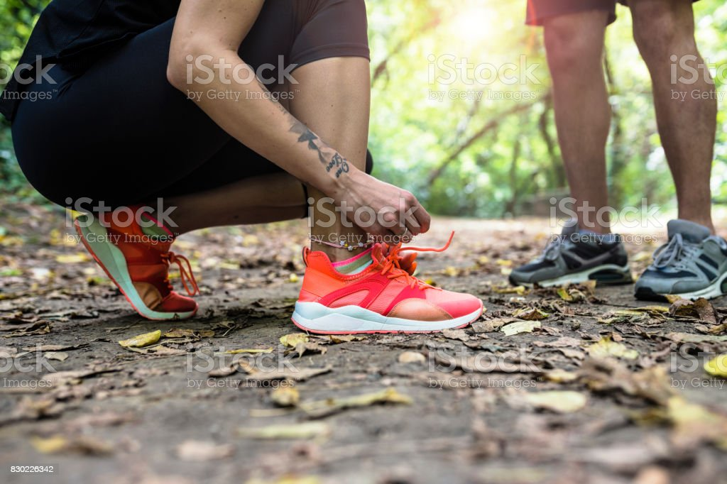 Tying sports shoes stock photo
