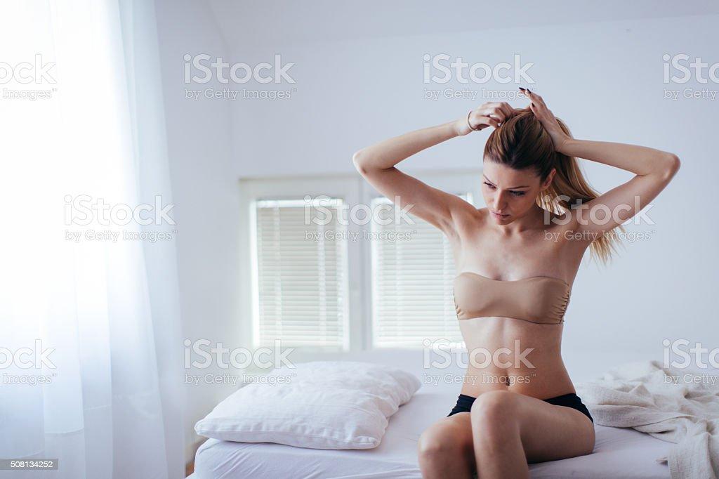 Tying the hair stock photo