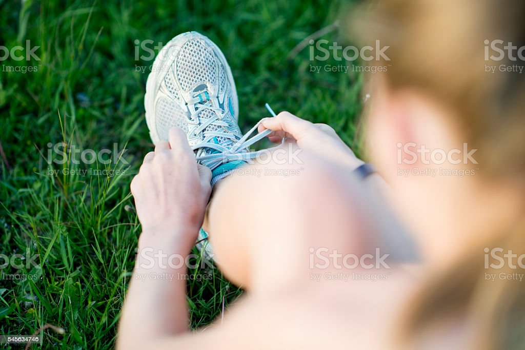Tying up a Pair of Tennis Shoes stock photo