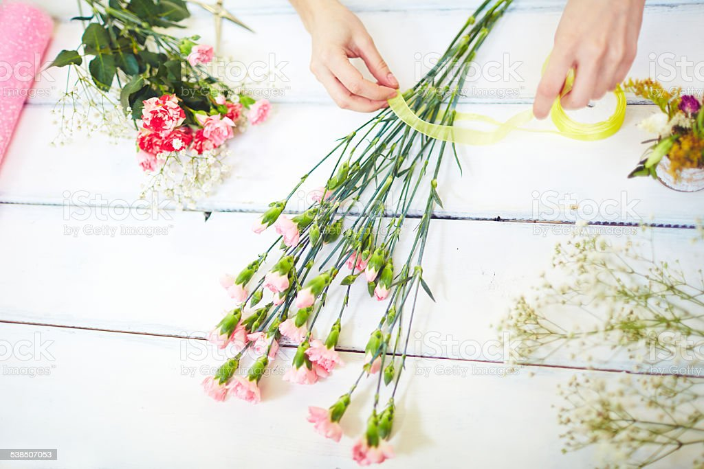 Tying up bouquet stock photo