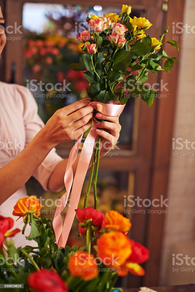 Tying up roses stock photo