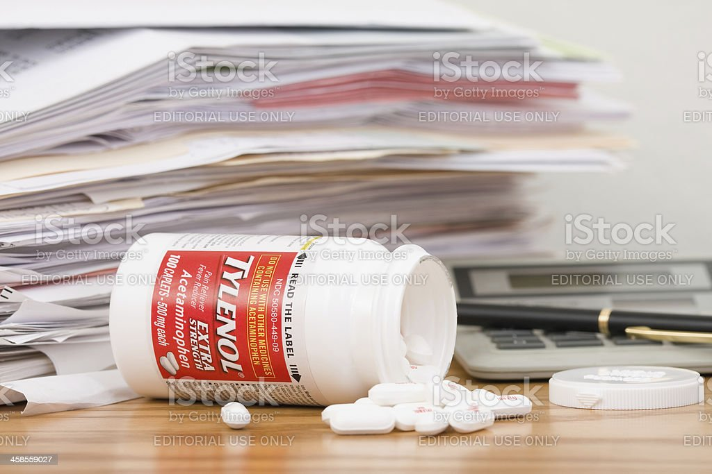 Tylenol and Pile of Paperwork stock photo