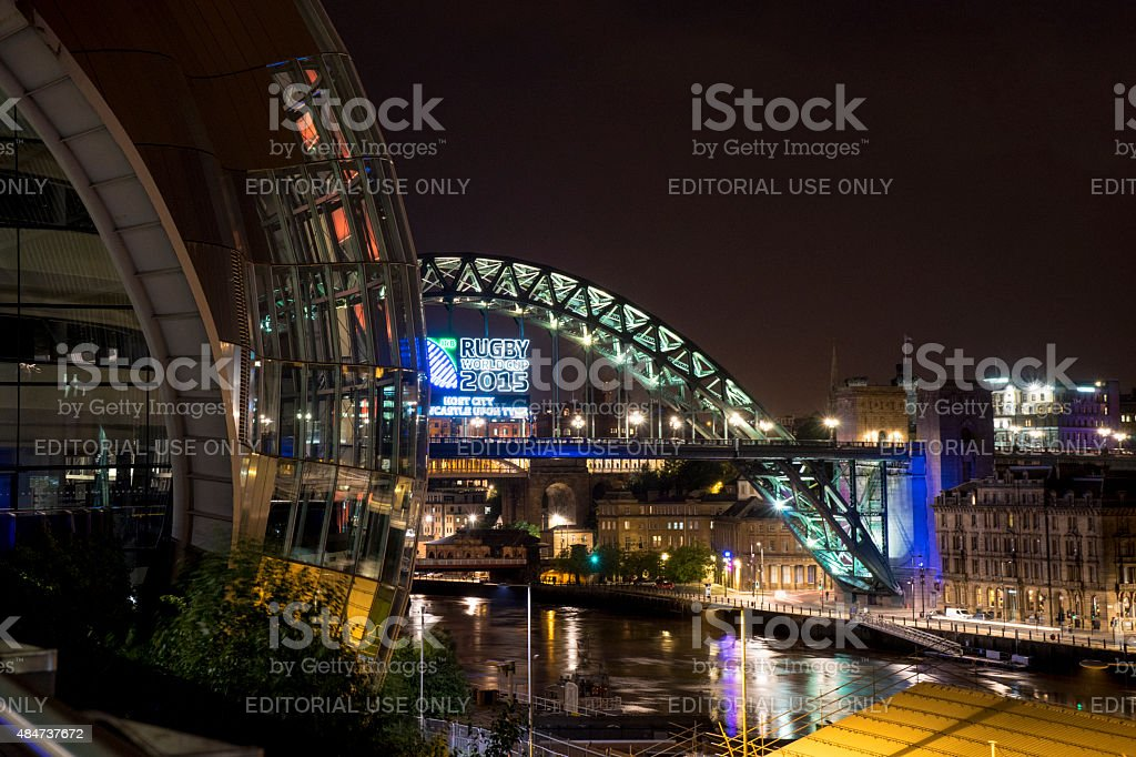 Tyne Bridge at night, with Rugby 2015 ad on stock photo