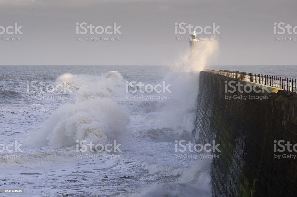 Tynemouth north pier and waves stock photo