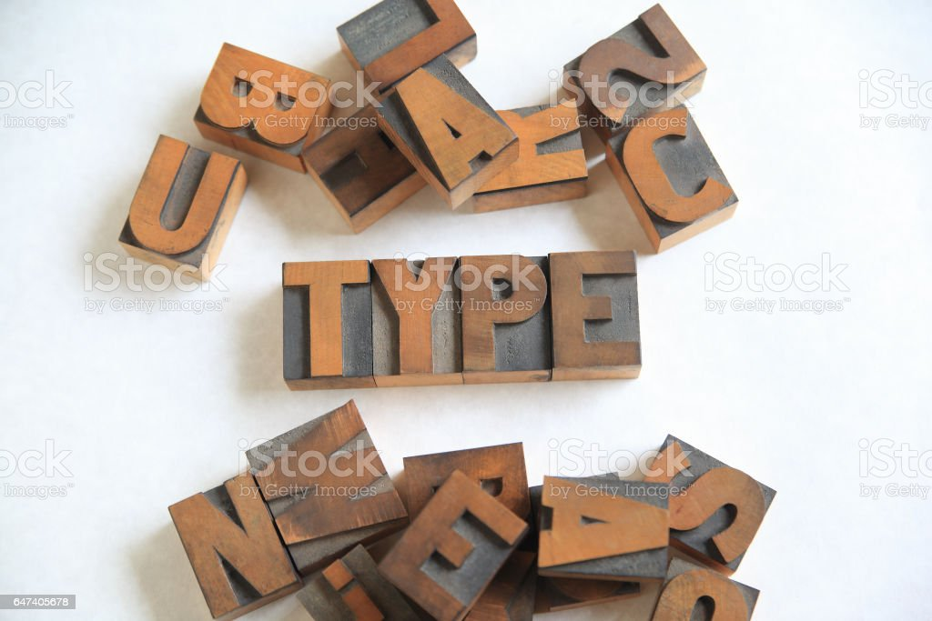 Type word with assorted wood letters stock photo