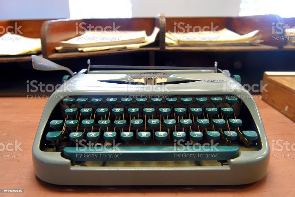Type writer on old desk stock photo
