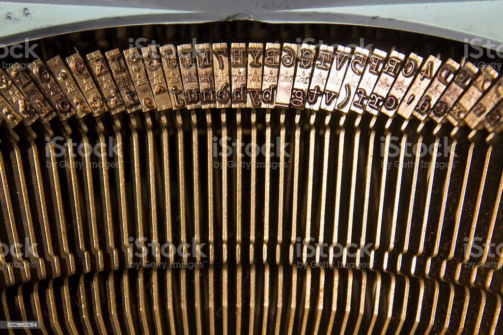 Typebars in a typewriter stock photo