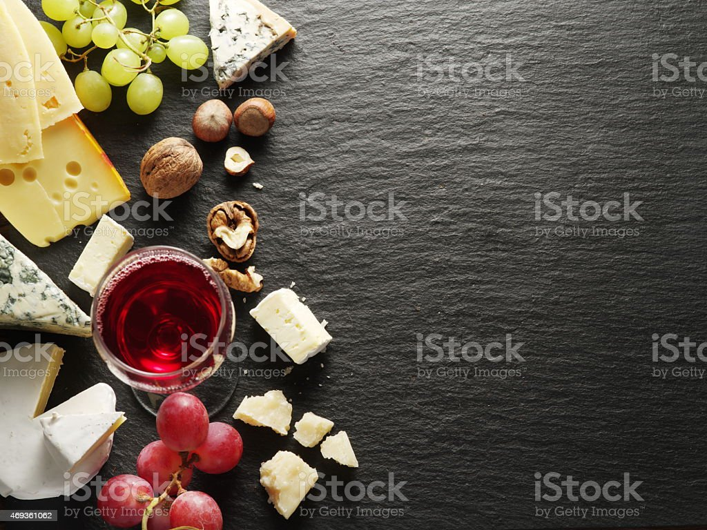 Types of cheeses with wine glass and fruits. stock photo