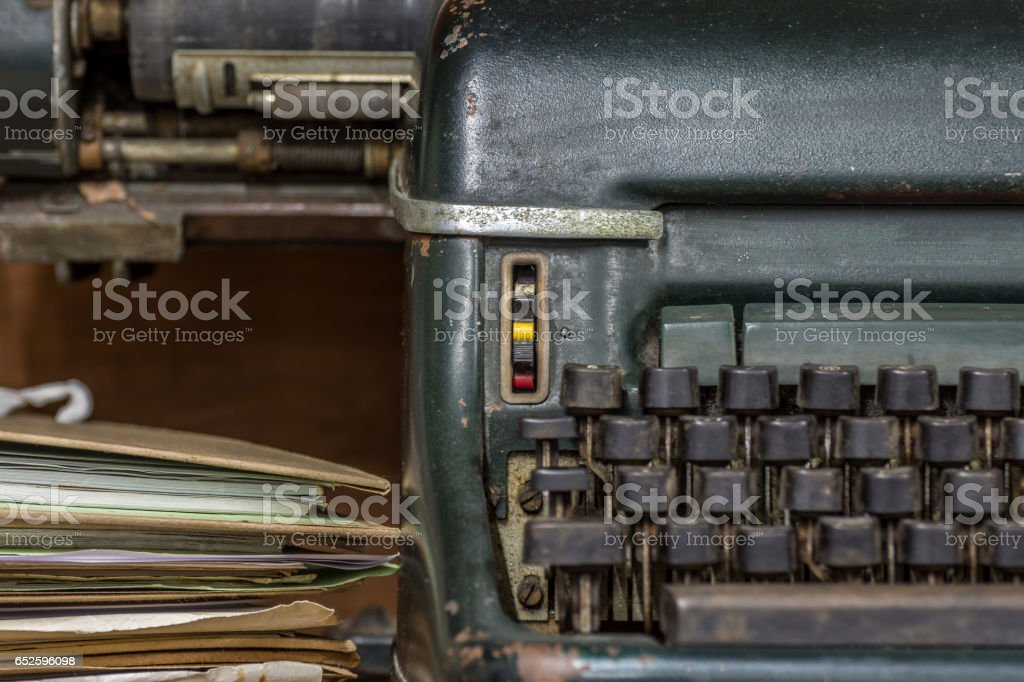 Typewriter antique vintage style with old documents or old letter stock photo