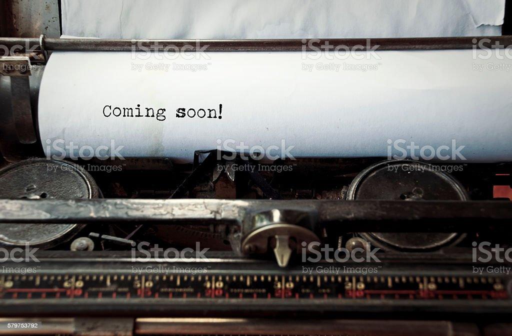 Typewriter caption: Coming soon stock photo