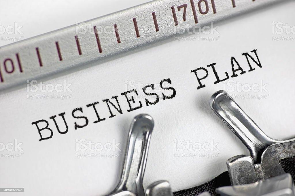 Typewriter detailed macro closeup typing text Business Plan, success metaphor stock photo