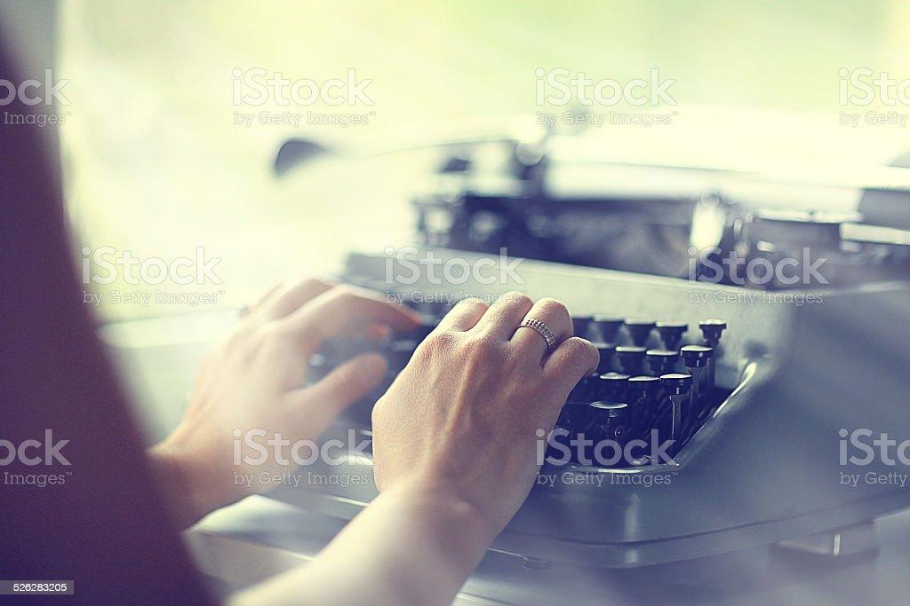 typewriter girl hands stock photo
