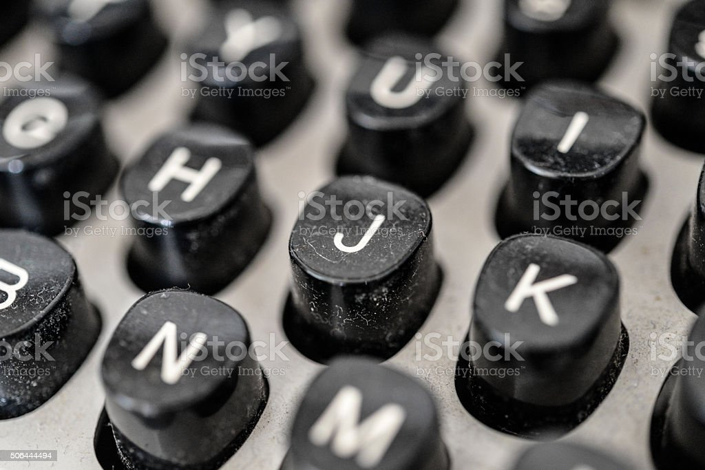 Typewriter keyboard detail, letter 'J' in focus stock photo