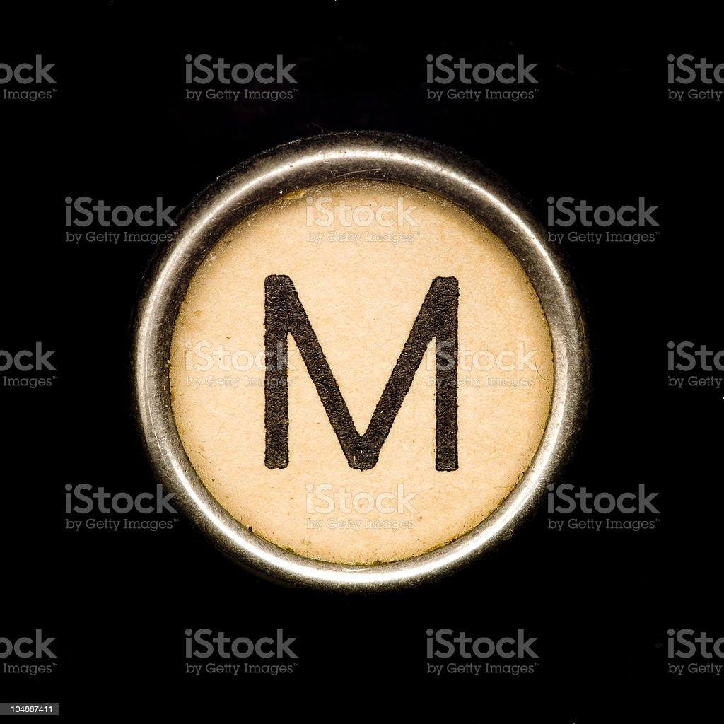 Typewriter letter M stock photo
