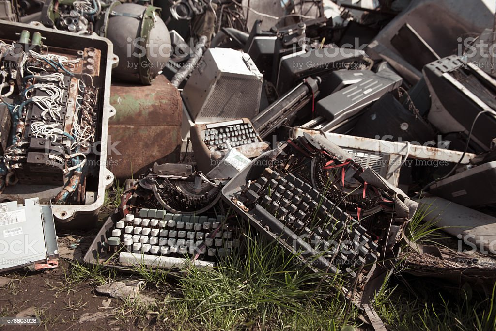 typewriter on a scrapyard stock photo