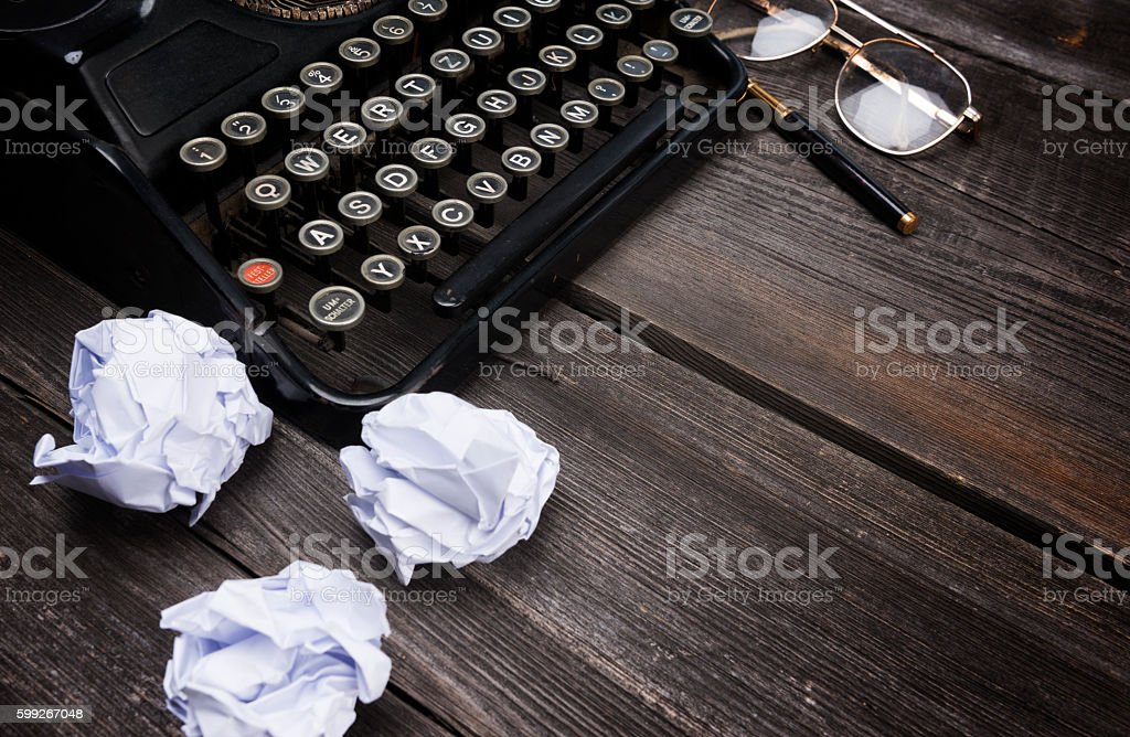 Typewriter on Wood stock photo