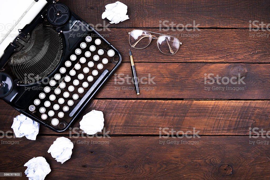 Typewriter on Wood stock photo