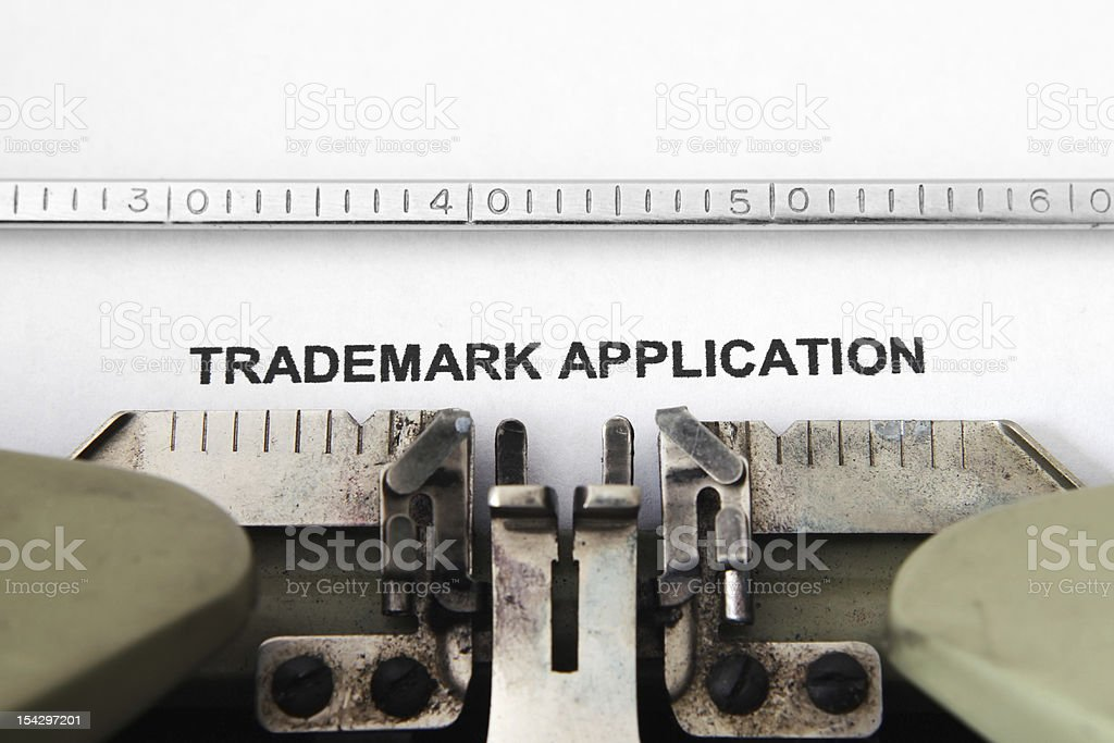 Typewriter typing out a trademark application in back ink stock photo