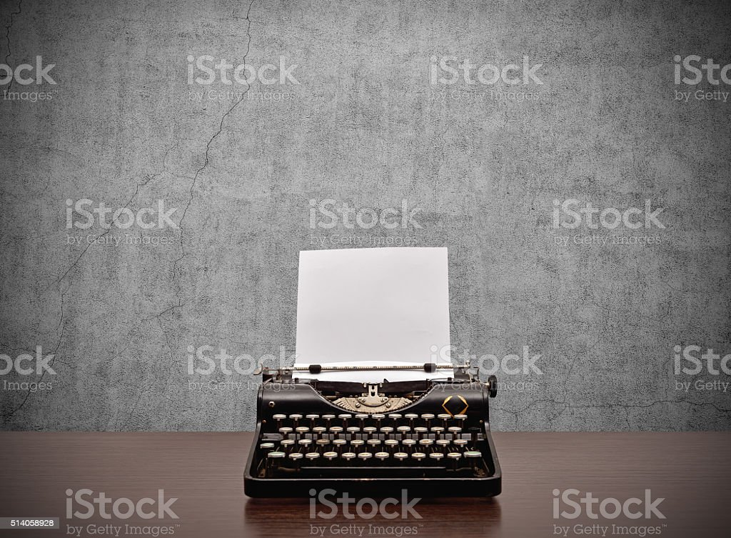 typewriter with blank paper stock photo