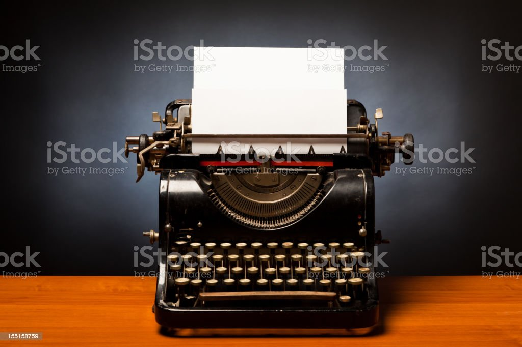 typewriter with blank sheet of paper stock photo