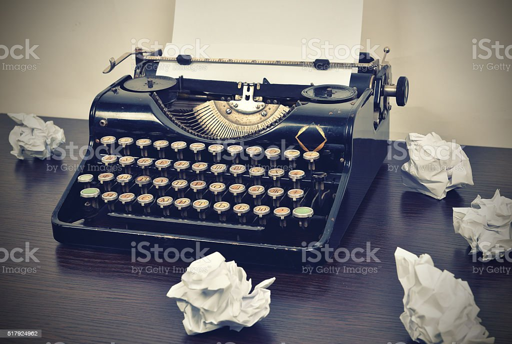 typewriter with crumpled paper stock photo