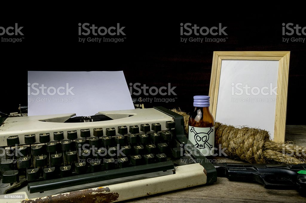 Typewriter with paper page and poison and gun. stock photo