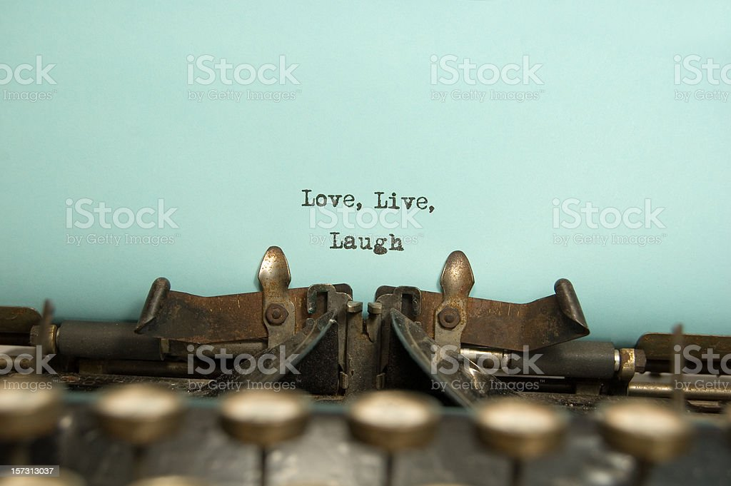 Typewriter with text love live laugh stock photo