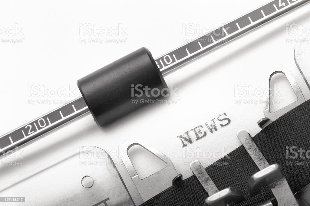 Typewriter with the word news on white paper royalty-free stock photo