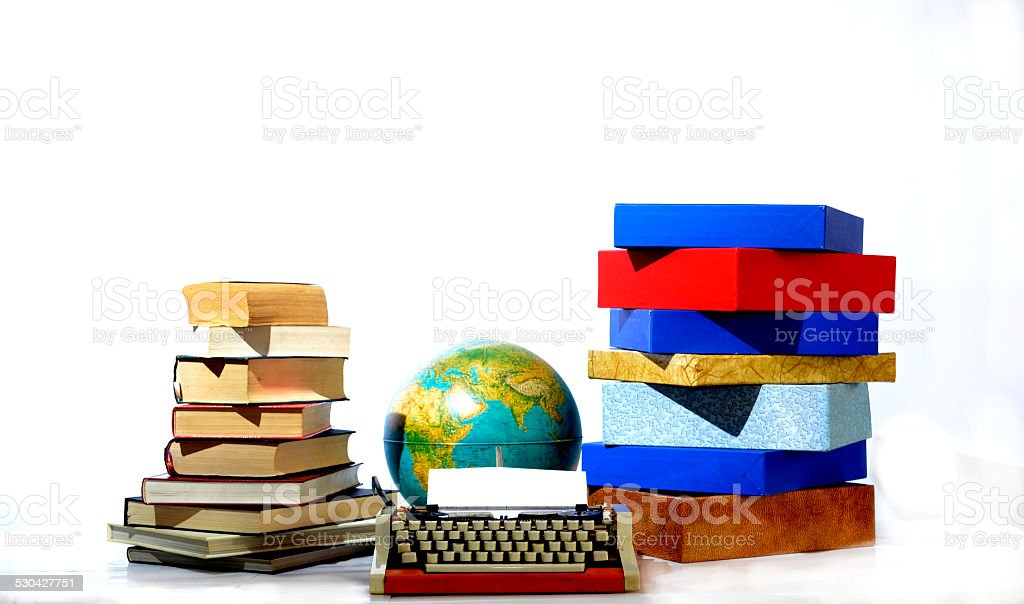 typewriters, books and boxes stock photo