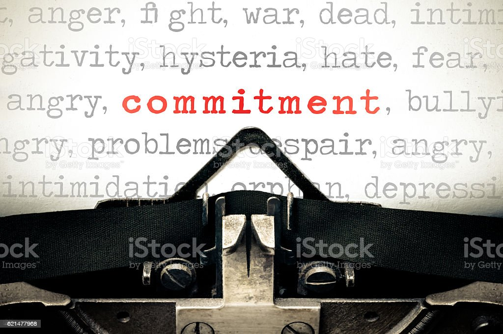 Typewritter with the word commitment stock photo