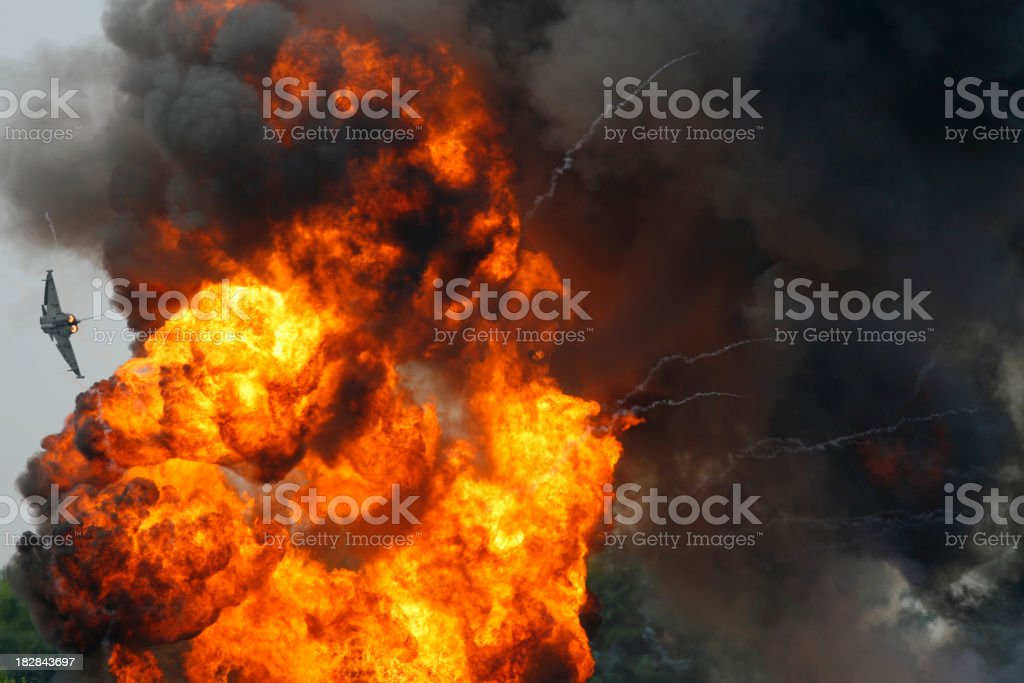 Typhoon Fighter Jet and Explosion stock photo