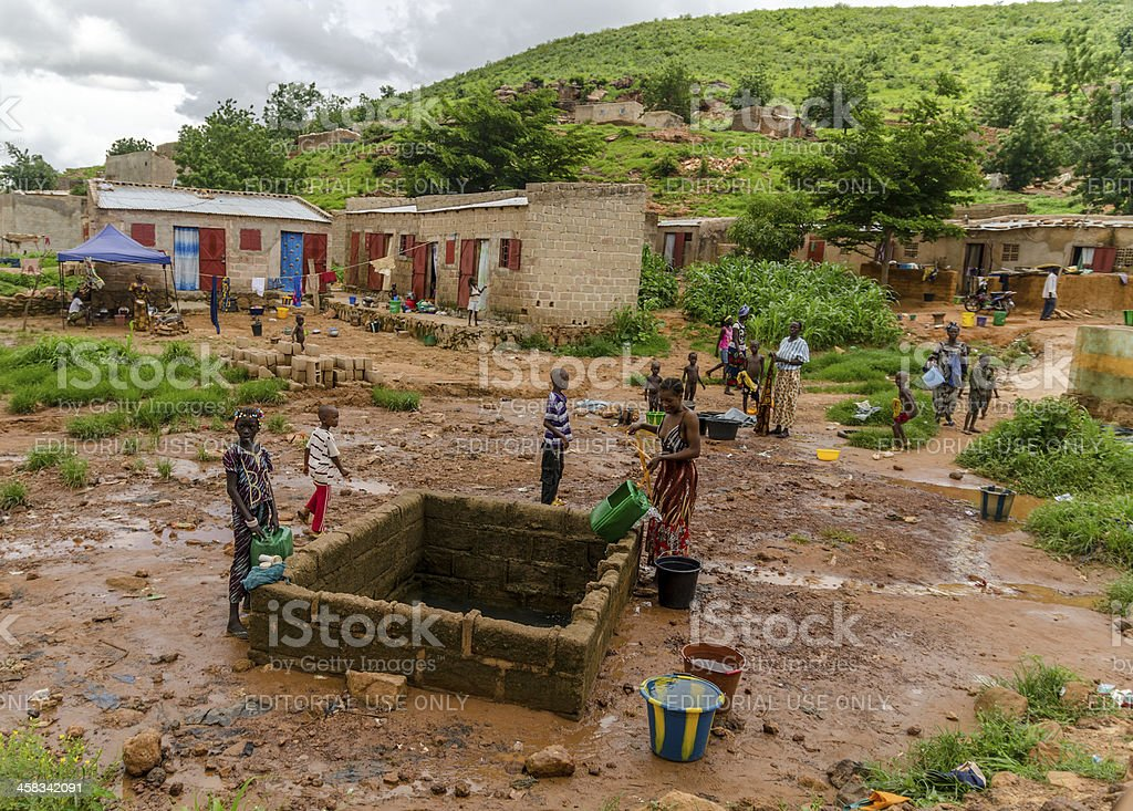 Typical African Well with people (Mali) stock photo