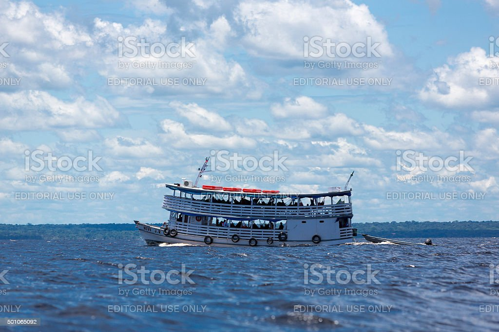 Typical Amazon wooden boat on Rio Negro in Manaus, Brazil stock photo