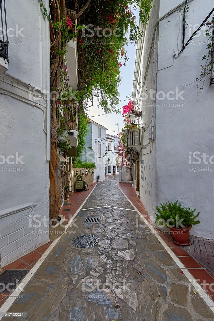 Typical Andalusian streets and balconies, with flowers stock photo