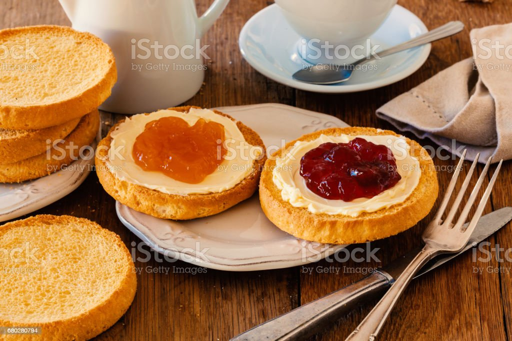 Typical breakfast from Holland with biscuit toast, butter and jam. stock photo