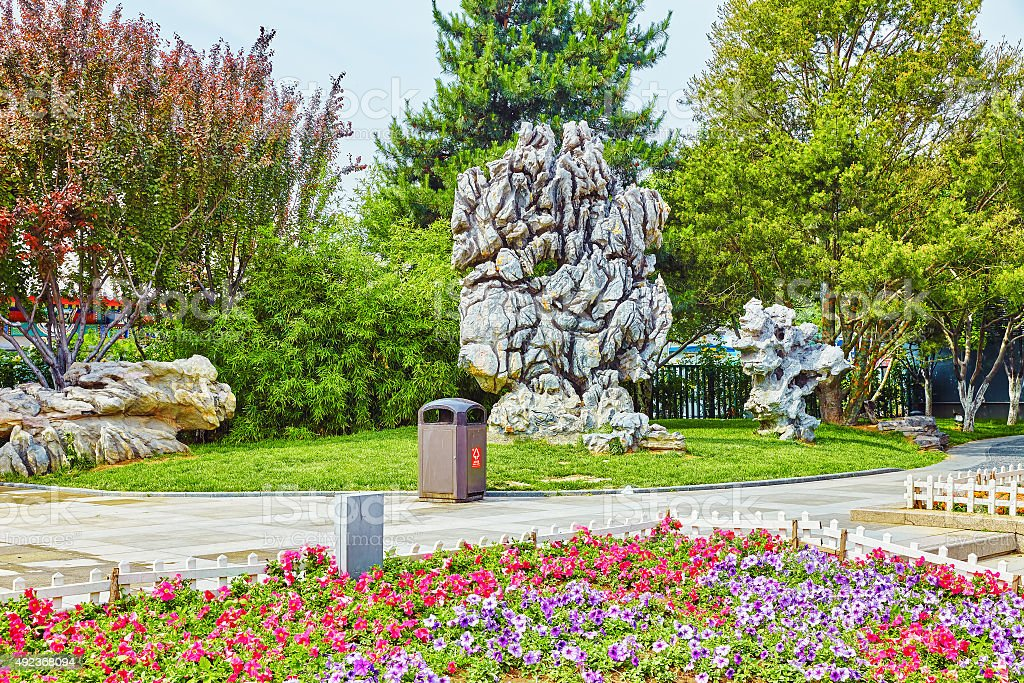 Typical Chinese garden,  park with bizarre rocks. Beijing. stock photo