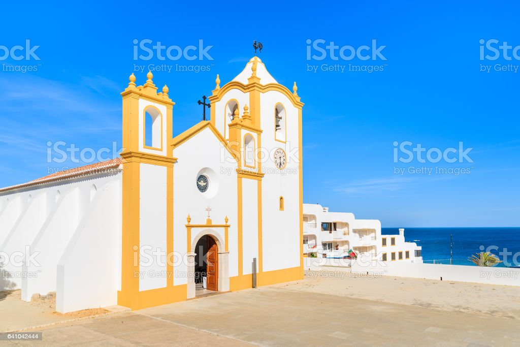 Typical church in Luz town on coast of Portugal stock photo