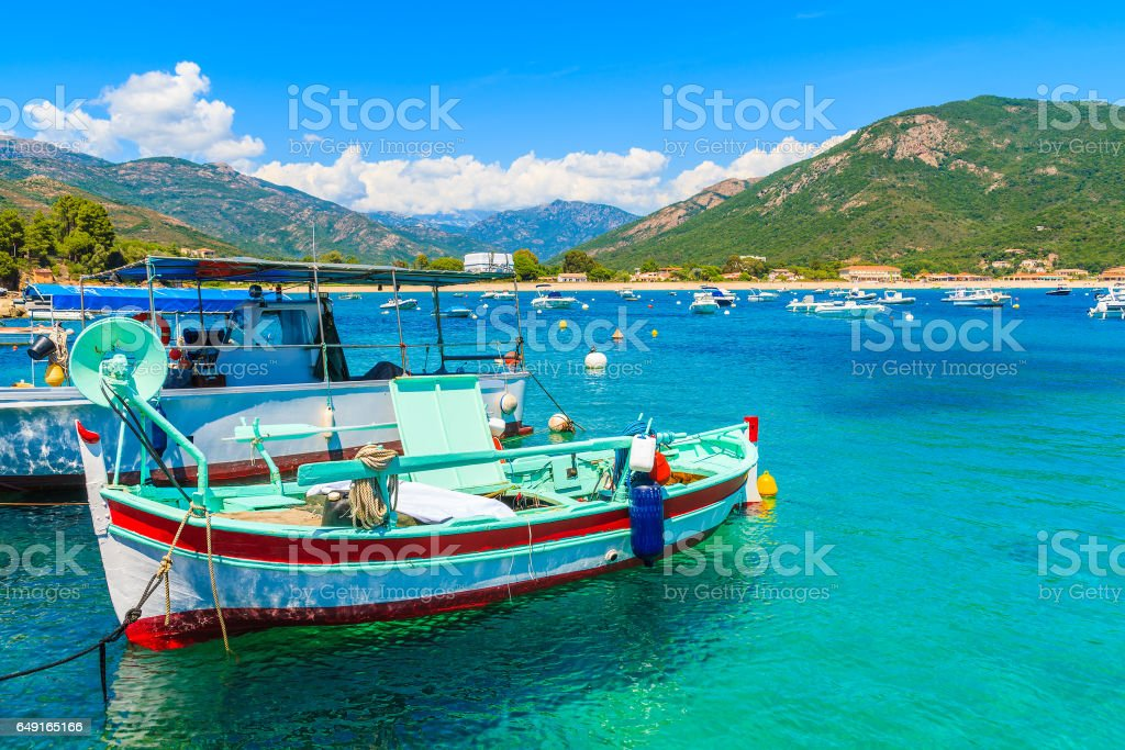 Typical colorful fishing boats in port on coast of southern Corsica island near Cargese town, France stock photo