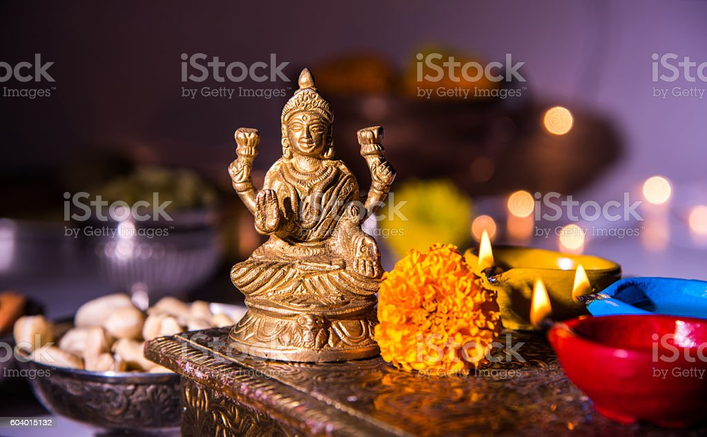 typical diwali celebration or puja in india with diya stock photo